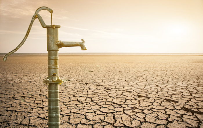 dry cracked earth. Water pipe valve in the desert. Background. It's hot, the global shortage of water on the planet. Background.